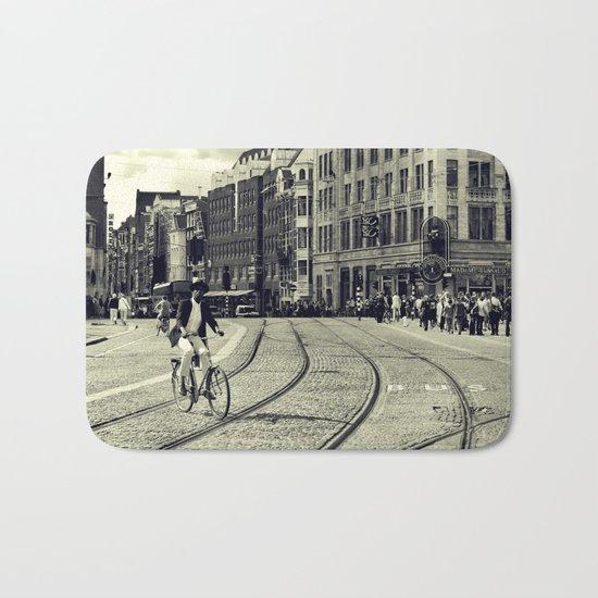 Cyclist over railway Bath Mat