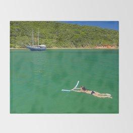 Woman swimming in green waters in Brazil Throw Blanket