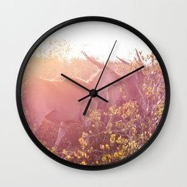 Eland walking through grasslands in South Africa at sunset Wall Clock