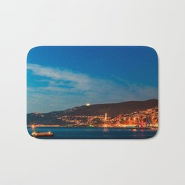 Colorful sunset in front of the city of Trieste Bath Mat