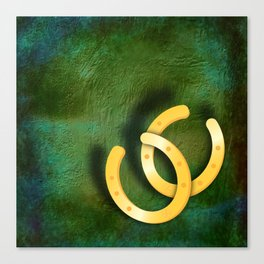 Lucky horseshoes on a textured green background Canvas Print