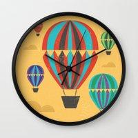 hot air balloons Wall Clocks featuring Hot Air Balloons by Marina Design