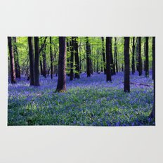 drowning in the bluebell sea Rug