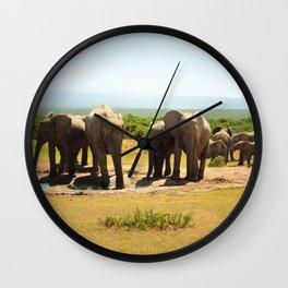 Elephants at the waterhole Wall Clock