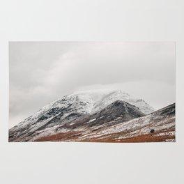 Whiteside peak covered in snow. Brackenthwaite, Cumbria, UK. Rug