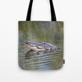 Large American alligator looking out of water in Florida lake Tote Bag