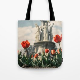 Tulips in front of a fountain. Tote Bag