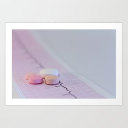 Some colored tablets on an electrocardiogram strip Art Print