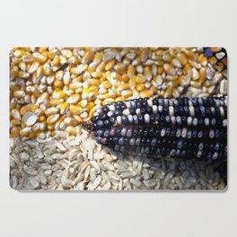 White, yellow and blue corn Cutting Board