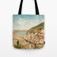 not all who wander are lost Tote Bags featuring Not All Who Wander Are Lost by happeemonkee