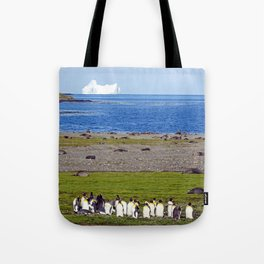 King Penguins on the beach with an Iceberg behind Tote Bag