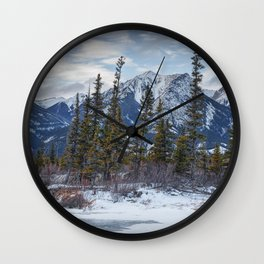 Pines at the edge of a lake in Jasper National Park Wall Clock