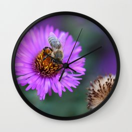 Bee on a violet flower Wall Clock