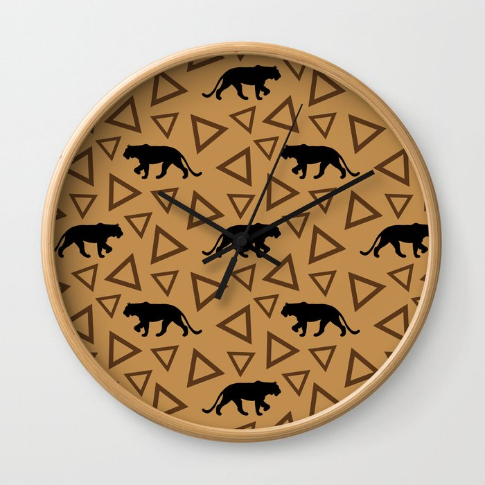 Wild African walking lioness silhouettes and abstract triangle shapes. Stylish classy warm brown latte color seamless retro vintage geometric animal nature pattern. Wall Clock