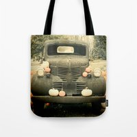truck Tote Bags featuring Pumpkin Truck by Toothpick Images
