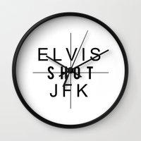 jfk Wall Clocks featuring ELVIS SHOT JFK by Bertrand Goncalves
