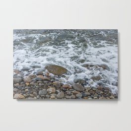 Wave washing over pebbles Metal Print