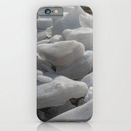 Ice melts on the ground under the warm morning sun iPhone Case