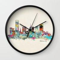 oklahoma Wall Clocks featuring Oklahoma City Oklahoma skyline by bri.buckley