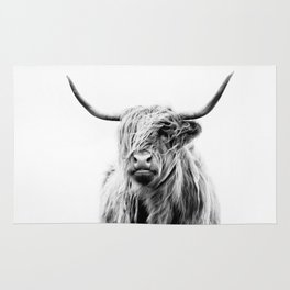 portrait of a highland cow Rug