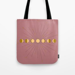 Moon Phases in gold with a starburst and dusty rose background Tote Bag