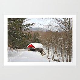 Red covered bridge in snowy landscape Art Print