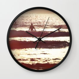 Sunset Surfers Wall Clock