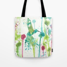 Colibri in a field of flowers Tote Bag