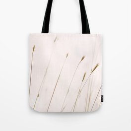 Tall grass against cloudy sky Tote Bag