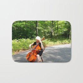 Female cellist. Bath Mat
