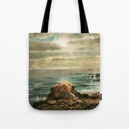 Sunlight through the Clouds over a Rocky Coast by Edmond Darch Lewis Tote Bag