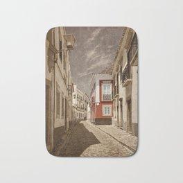 Sepia treatment of a cobbled street, Portugal Bath Mat