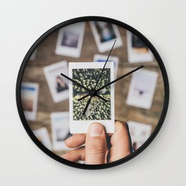 Holding photo prints Wall Clock