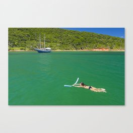 Woman swimming in green waters in Brazil Canvas Print