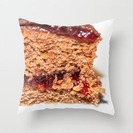 Detail of slice of chocolate cake with strawberry jam filling Throw Pillow