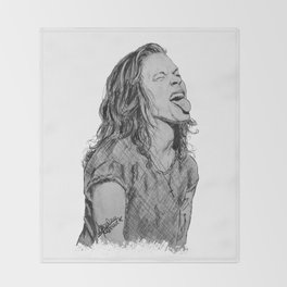 Harry Styles with tongue out Throw Blanket