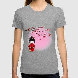 Japanese kokeshi doll at sakura blossoms T-shirt