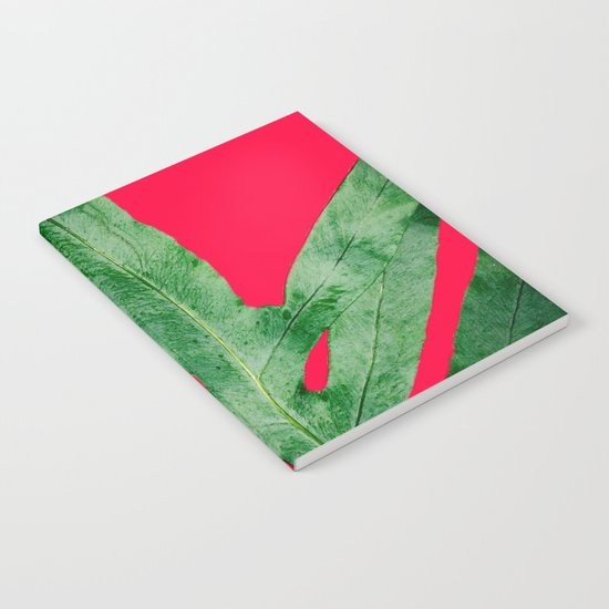Green Fern on Bright Red Notebook