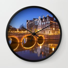 Bridges over canals in Amsterdam at night Wall Clock