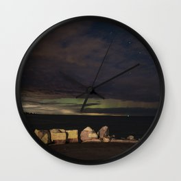 New Years eve Aurora peaking though the clouds Wall Clock