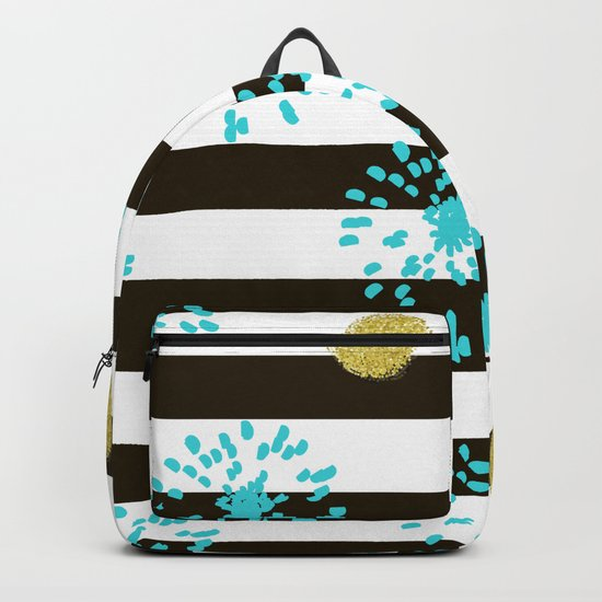 A festive mood. Striped background black and white with blue fireworks and Golden peas . Backpack