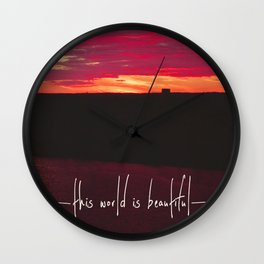 this world is beautiful Wall Clock