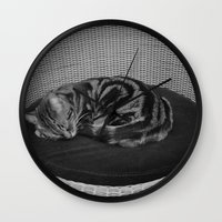 sofa Wall Clocks featuring sleeping cat on sofa by gzm_guvenc