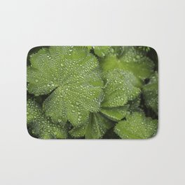 Water drops on fresh green Leaf Bath Mat