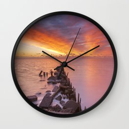 Sunrise over sea on the island of Texel, The Netherlands Wall Clock
