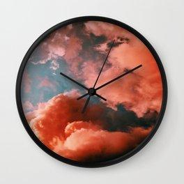 Orange smoke and blue sky Wall Clock