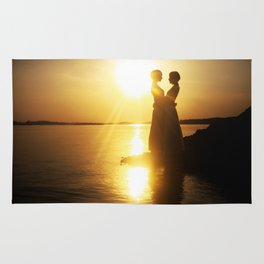 Silhouette couple kissing over sunset background Rug