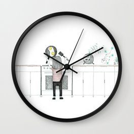 Learning to cook while mom's at work Wall Clock