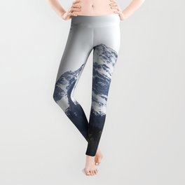 Winter and Spring - green trees and snowy mountains Leggings