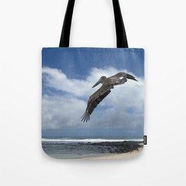 Pelican above the beach Tote Bag